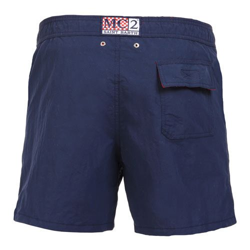 NAVY BLUE OWNER SWIM SHORTS WITH EMBROIDERY WRITING Solid navy blue OWNER long Swim Shorts. Saint Barth LA COTONE DU VENT MC2 embroidery on front at lateral side. Two side pockets. Back Velcro flap pocket. MC2 label on waist to the reverse. Elastic waistband with adjustable drawstring. Internal net. COMPOSITION: 100% NYLON. Model wears size M, he is 189 cm tall and weighs 86 Kg.
