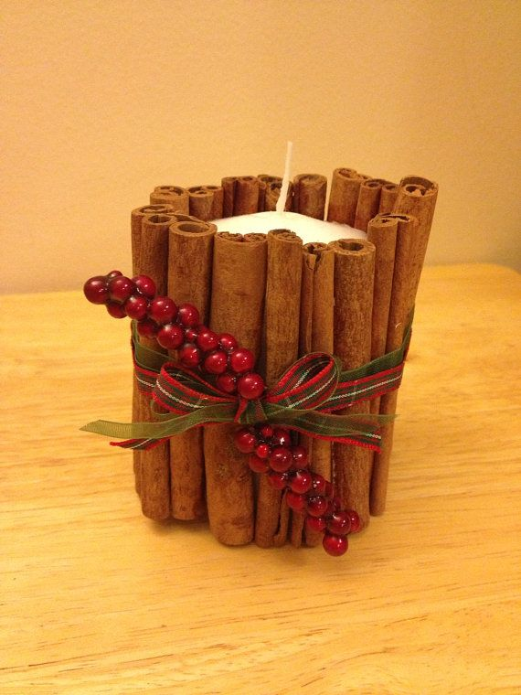 Cinnamon decorated Christmas candle.  on Etsy, £6.00