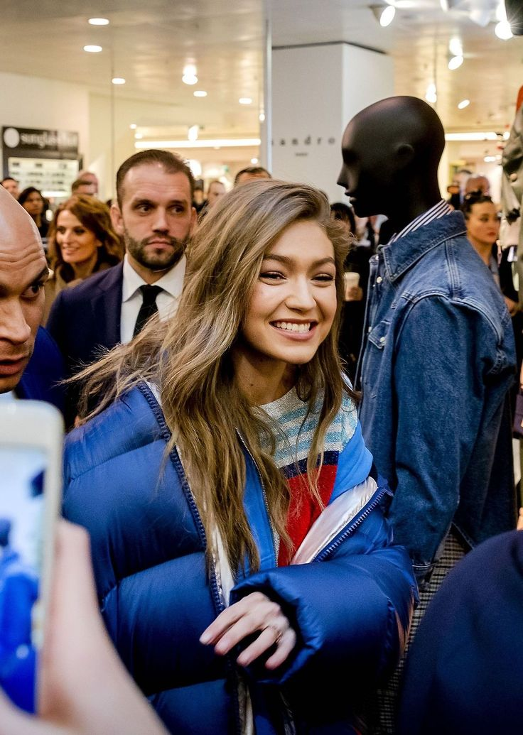 Gigi Hadid Daily - airport style - royal blue puffer jacket, striped sweater