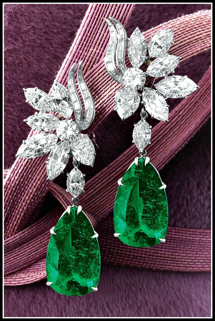 Harry Winston earrings feature two emeralds, weighing 16.57 and 14.58 carats respectively, and two clustered surmounts with 14 total carats of marquise-, pear-shaped, brilliant-cut and baguette diamonds