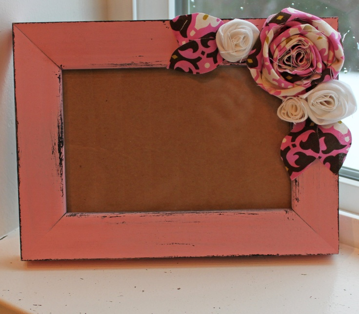 Love this idea!  Fabric flowers on a basic picture frame.
