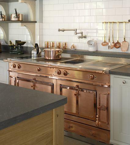 Pot-filler tap in bespoke cook's kitchen in oak and copper by Artichoke www.artichoke-ltd.com