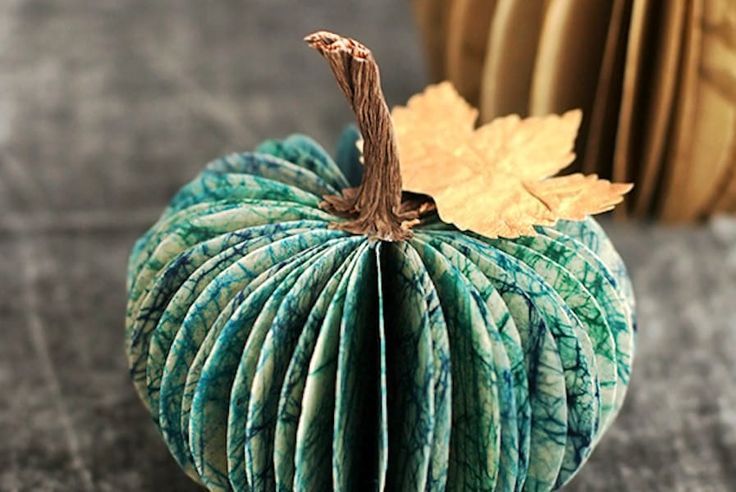 These sweet paper pumpkins by Minted would look fantastic scattered across your table, and you can use them year after year.