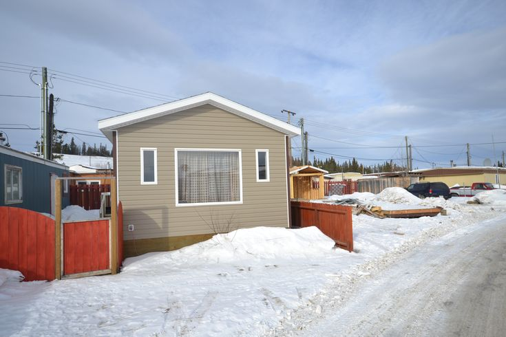 """$119,000 Takhini Trailer Park 26-833 Range Road – MLS 8115 2009 – 2 MONTHS PAD RENT FREE! 688 sq ft mobile home, 1 bed 1 bath, overlooks Whitehorse and Yukon River valley, completely rebuilt in 2009 with 6"""" walls, R20 and R40 insulation, new plumbing and heat tape, large master bedroom, ample closet space, bright spacious bathroom with unimold soaker tub, open concept kitchen living dining area receives lots of sunlight, approved oil tank."""