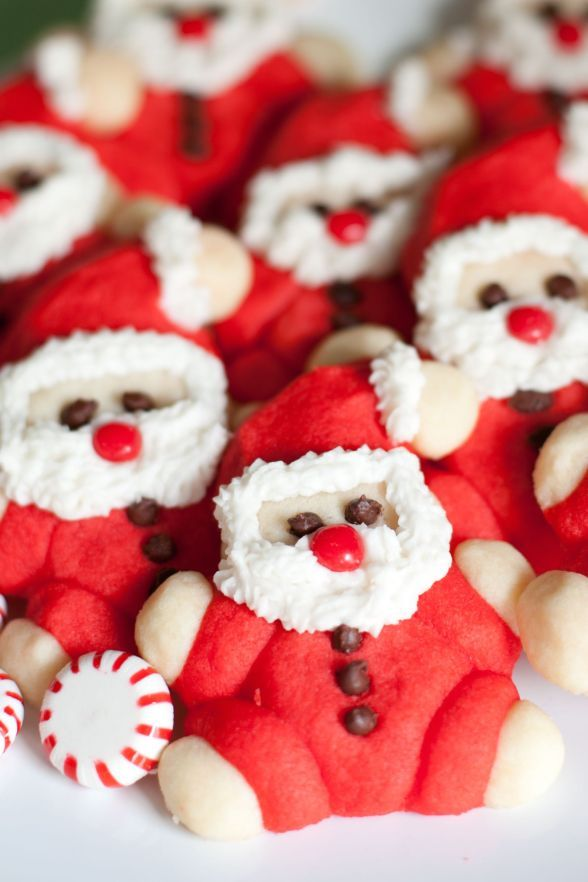 """Santa Cookies - these are so cute and look easy enough to make. Key word here being """"look"""" easy."""
