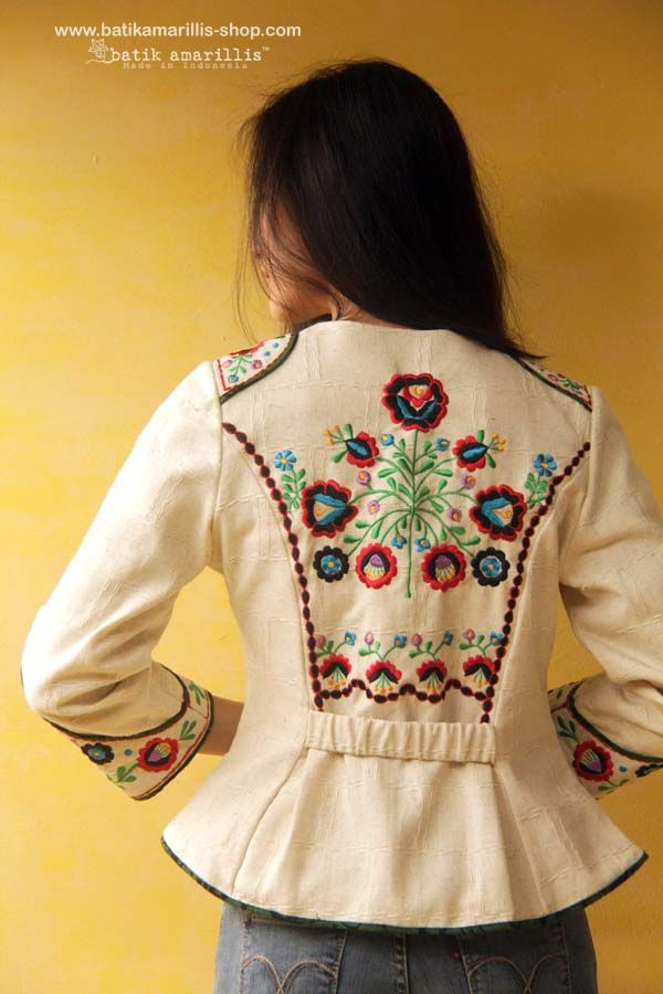 Batik Amarillis Made in Indonesia proudly presents .... Batik Amarillis's Waterloo jacket stunning military inspired jacket,this contemporary style is accented with exquisite hungarian   embroidery on the shoulders epaulettes & sleeves also an exposed extraordinary under-layer.