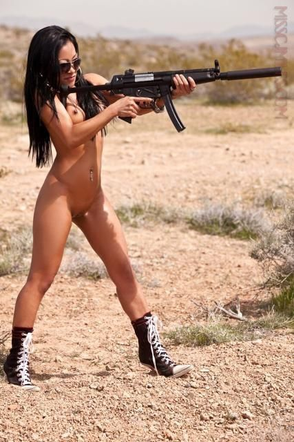 Naked Asian Girl With A Weapon