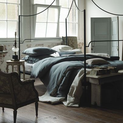Romantic bed, antique furniture in industrial interior. Is it possible to get a manly or at least not obviously feminine four post bed? I think this is the closest I'm going to get.