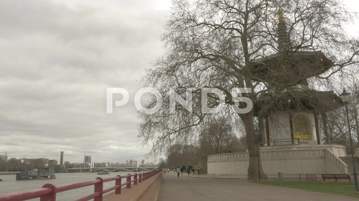 4K Buddhist Temple By River Thames Joggers Running Past - Stock Footage | by RyanJonesFilms
