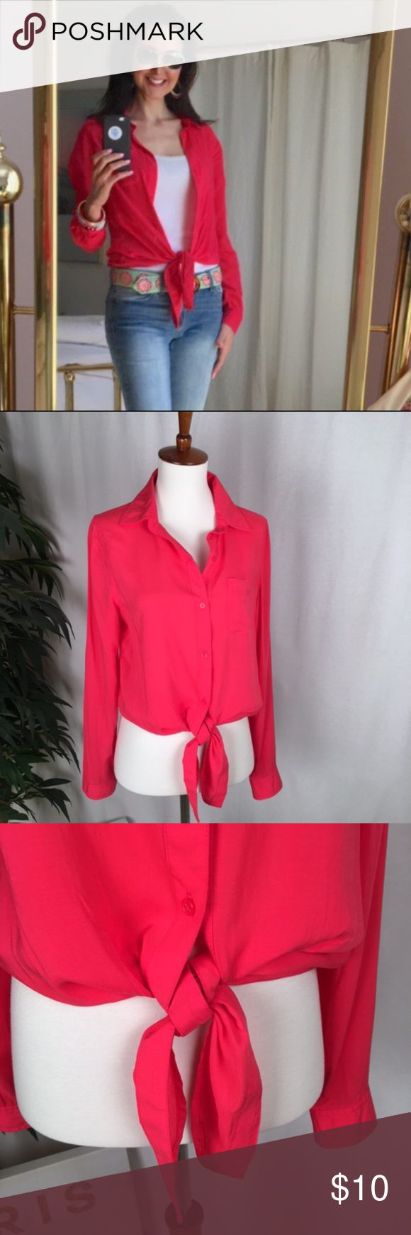 "Old Navy Coral Front Tie Blouse This pretty Old Navy button-down blouse can be worn w/ the front tied or hanging open for a longer shirt look. The color is CORAL (not pink)! The fabric is rayon & looks like silk. You'll be surprised this is an Old Navy item! It is in VERY GOOD condition; all buttons are in tack. Wear it layered w/a camisole like I did in the picture, or just the shirt alone. Looks great with jeans/white pants/skirt. NO Smoking/Pets // Measures: 26"" down back UNTIED/Shoulder…"