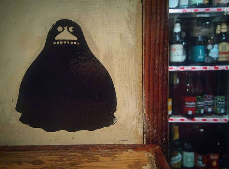 """Buka keeps your beer safe   Buka/the Groke/Mörkö is one of characters of book & animation - Moomins - """"She appears as a ghost-like hill-shaped body with two cold staring eyes and a wide row of white shiny teeth."""" #buka #groke #mörkö #moomins #staradrukarnia #drukarnia #beer #cerveza #piwo #pub #atnight #animation #muminki #rzeszow #rzeszow #allaboutdetails #mural #streetartnews #streetart"""
