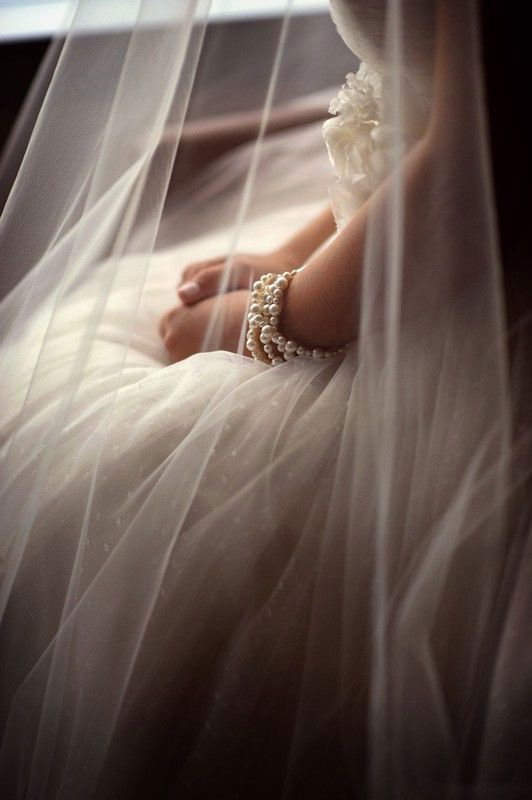 Love love love photographing details under veils...makes wonderfully soft bokeh for an ethereal feel to the photo