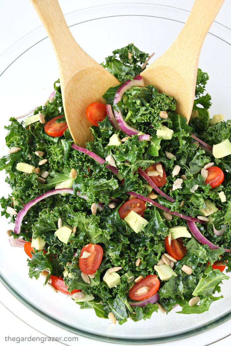 The salad that makes us *crave* kale!! Easy marinated kale salad with avocado, tomato, and a super simple dressing (vegan, gluten-free)