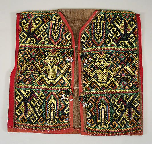 Jacket  Date:     early to mid-20th century Geography:     Malaysia, Borneo Culture:     Maloh or Iban people Medium:     Cotton, beads, bark cloth, shell
