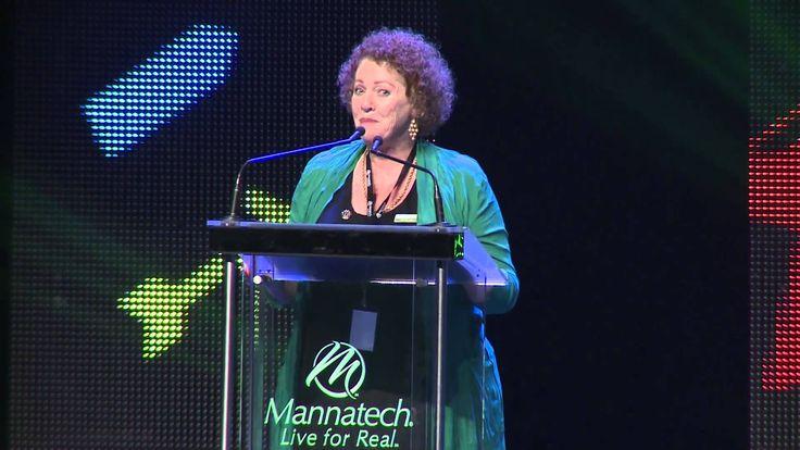 Bronze Presidential Director Karen Denniss accepting the 2013 Mannatech Associate of the Year award.