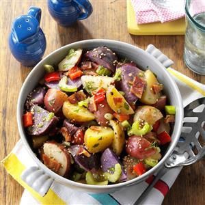 Red, White & Blue Potato Salad Recipe -Tossing the cooked potatoes with stock and wine right after you drain them infuses them with flavor. The liquid absorbs like magic. —George Levinthal, Goleta, California