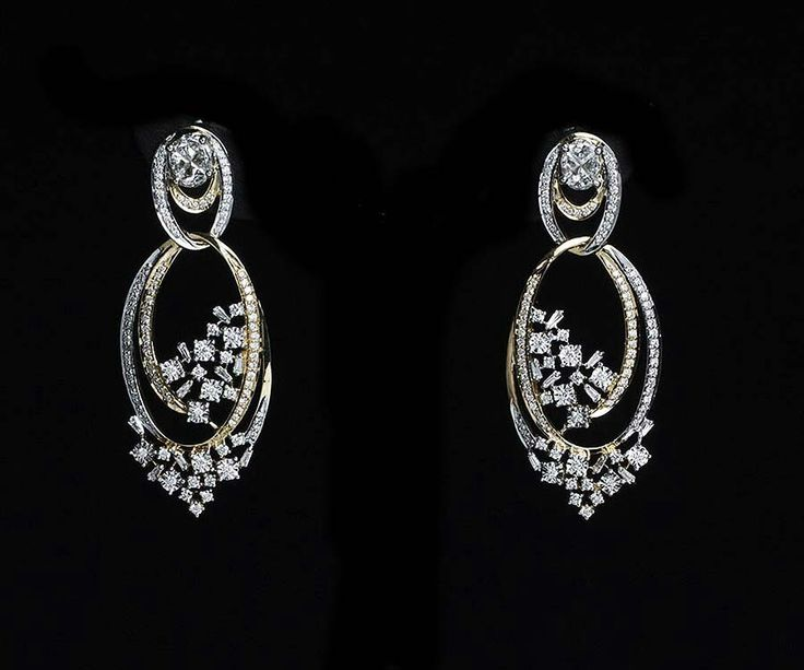 These yellow and white gold diamond-studded earrings from Tanishq's new Inara collection represent families of stars spinning in endless spirals.