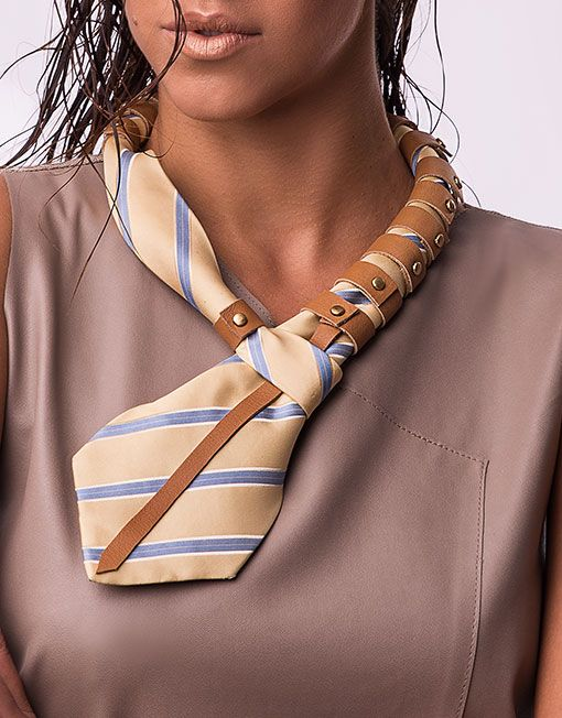 Repurposed tie redesigned into a fashion statement neck piece embellished with handcut real leather details.  Design: One of a Kind