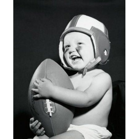 Close-up of a baby boy holding a football Canvas Art - (24 x 36)