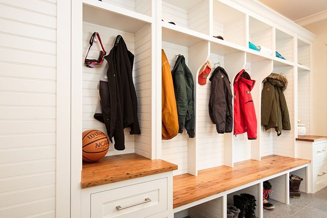 We take our Mudroom's seriously at RiverStone Custom Builders. Most our ordinary, we try to give ours flare and style. Our hope is this millwork is covered w/ bookbags, sneakers and jackets and sweatshirts as if we forgot to install the hooks..... But, love the use of horizontal beadboard on the cabinet doors & back panel of the cubbies. Then, #reclaimed wood is used for the bench and countertop materials. Any mom would be pumped to have this space be the first thing any guest sees when they…