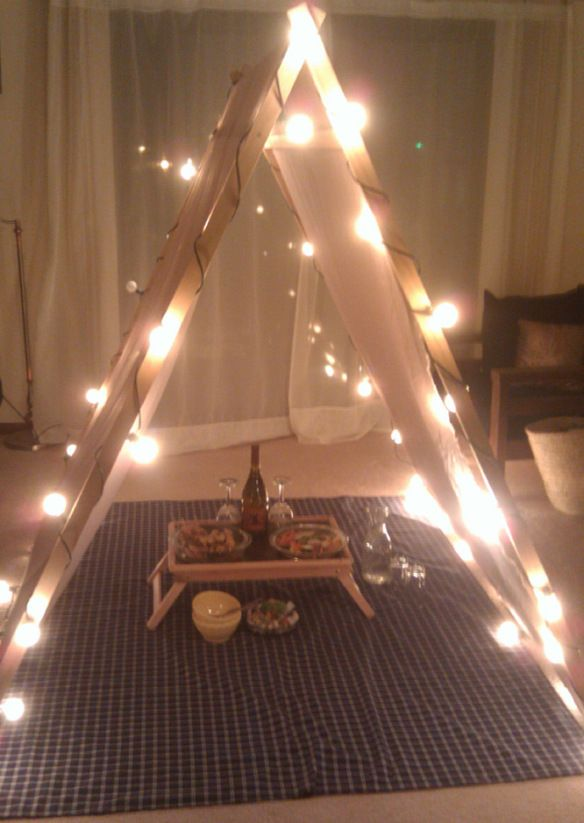 DIY tent for a romantic dinner in. Dudes, listen up, ROMANCE is where it's at. Lady loves will adore this, and LED string lights are key: http://www.flashingblinkylights.com/sparklingwhiteballledpartylights.html?utm_source=pinterest&utm_medium=led%20string%20lights&utm_campaign=cute%20valentines%20day%20ideas
