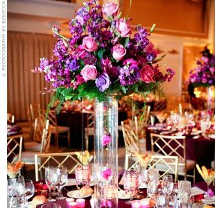 big purple floral centerpieces will look so vibrant if you keep to the B&W for the rest of the decor