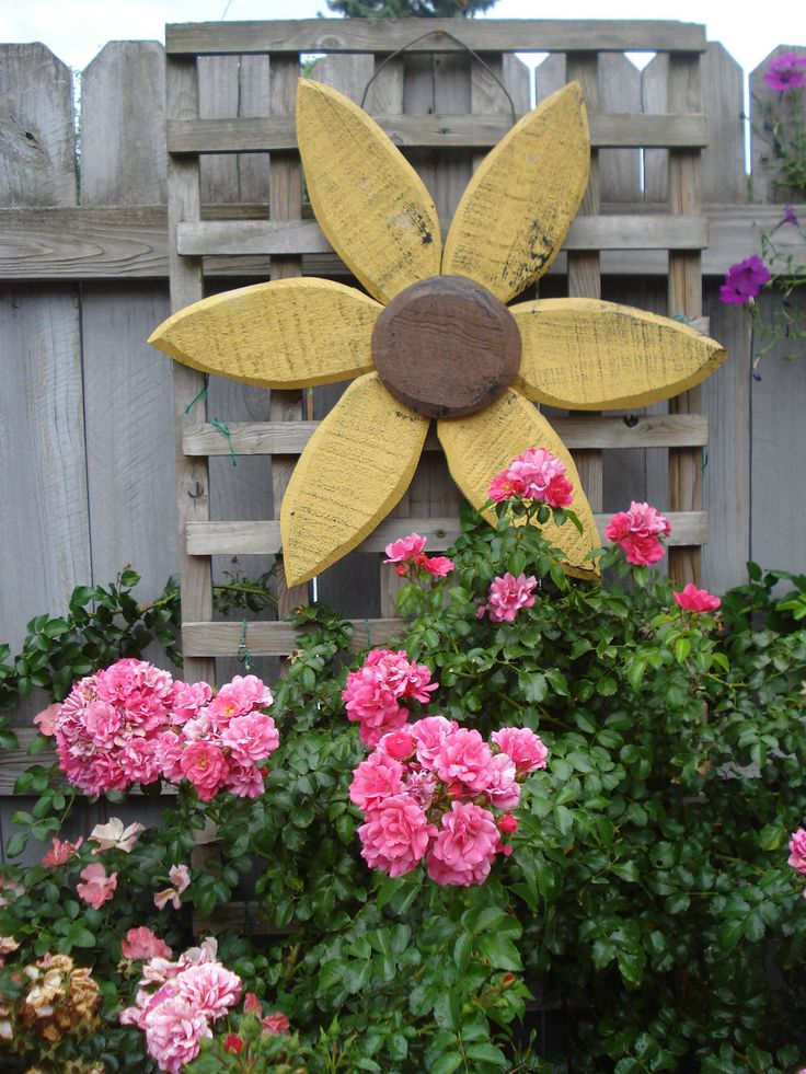Wooden Sunflower replaces old pink door in garden, Summer 2012