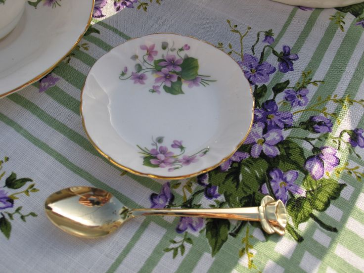 """Little spoon rest or """"butter pat/tea bag rest"""" in violets.  Princess house Hammersley Victorian Violets.  I have two available for rent."""