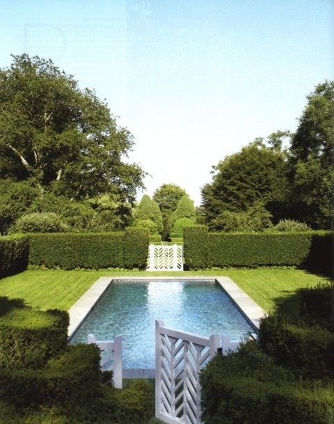 Perfect pool surrounded by clipped boxwoods with herringbone fretwork gates at the Southampton estate of Catie Marron, former banker and Vogue editor.: Lap Pools, Boxwood Hedges, Dreams Home, Gardens Gates, Pools Surroundings, Pools Gardens, Green Pools, Outdoor Spaces, Dreams Pools