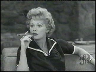 lucille ball smoking a cigar - there is something very sexy about a woman smoking a cigar.