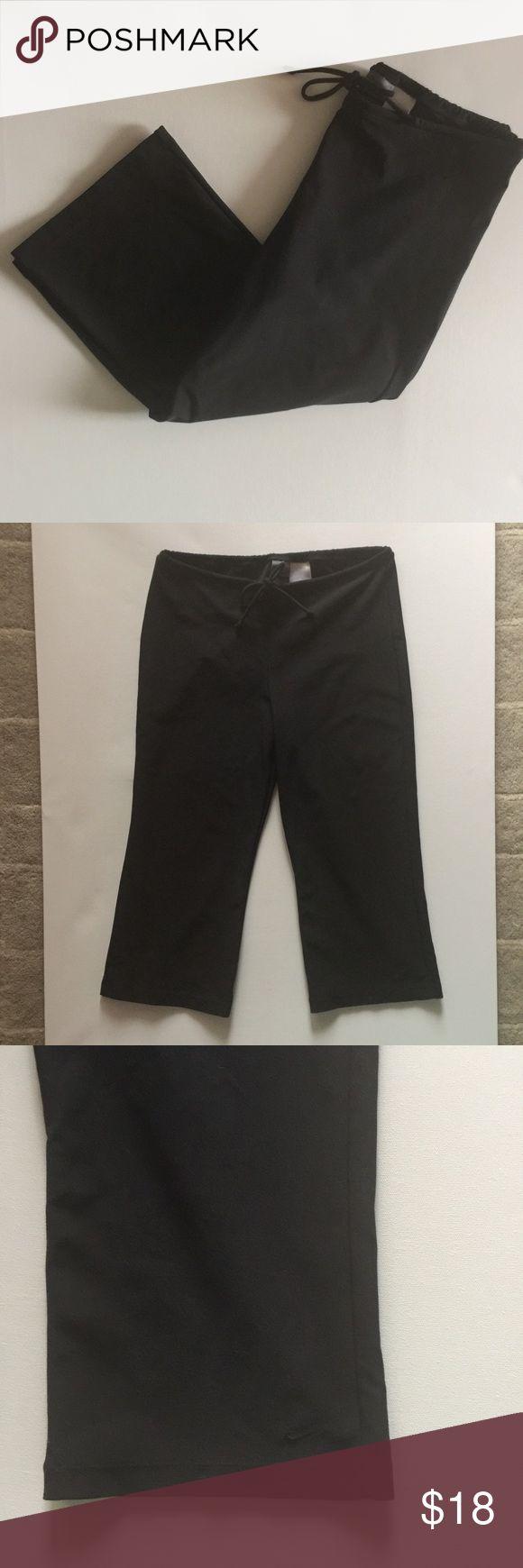 Nike black crop pants- size medium Nike black crop pants - size medium. Lighting is poor and casting shadows - not fading. Drawstring waist. Nike Pants Track Pants & Joggers