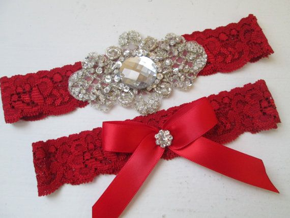 Red Lace Wedding Garter Set with Champagne Lace bridal patch, Bling, Crystals, Rhinestones, Vintage style One Brides Garter to Keep, one to Toss  www.etsy.com/shop/GibsonGirlGarters  Beautiful Red lace wedding garter embellished with crystals, bling and rhinestones and beautiful champagne thread embroidery patch.  Comes with Matching Toss Garter.  Stretches up to 22 inches around. Lace width measures 1.2 Inches.  ***Your choice of Toss Garter with Red Bow (1st & 2nd Photo) or Ivory Bow (3rd…