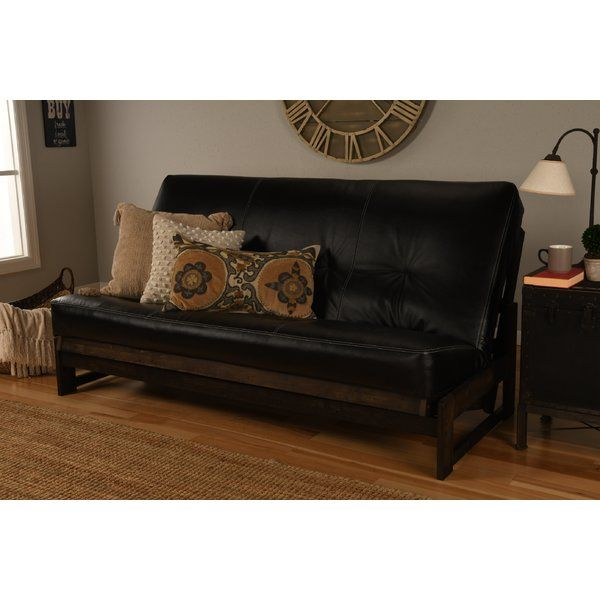 The Futon Is A Clic Hardwood Frame
