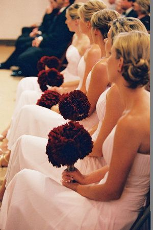 Love the contrast of the deep red bridesmaids' bouquets against their pink gowns