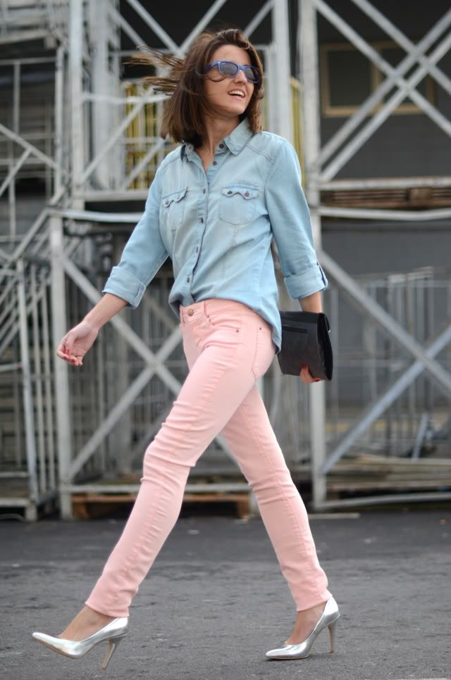 Shop this look for $124:  http://lookastic.com/women/looks/light-blue-shirt-and-black-clutch-and-pink-skinny-jeans-and-silver-heels/1897  — Light Blue Denim Shirt  — Black Leather Clutch  — Pink Skinny Jeans  — Silver Leather Pumps