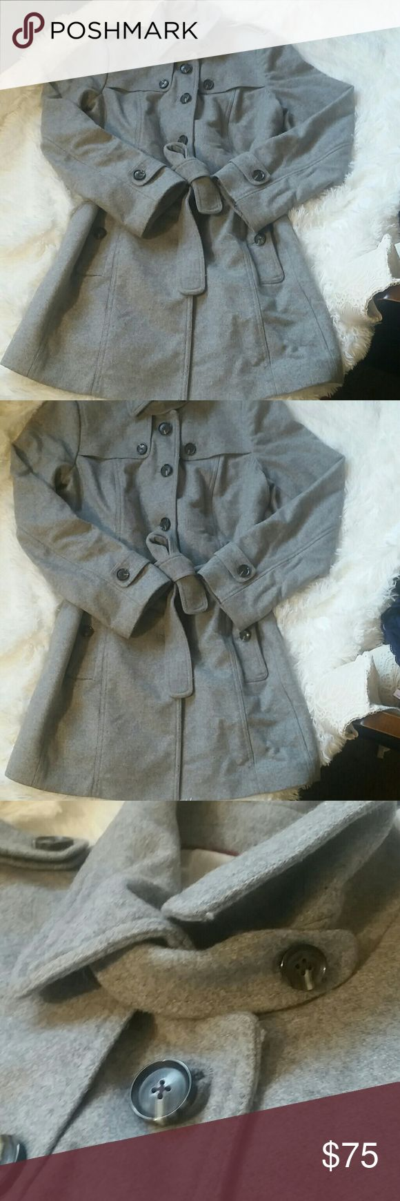 Banana Republic wool winter coat Grey wool winter coat by Banana Republic. In excellent used condition. Beautifully lined with red piping. Extra button still attached inside! Banana Republic Jackets & Coats Pea Coats