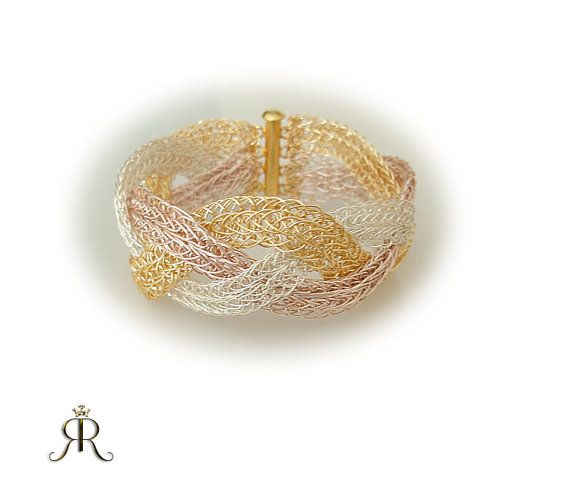 Braided Cuff Bracelet Tri color in Rose Gold, Yellow Gold and Silver, non tarnish wire, Wire Crochet Jewelry. A gorgeous and elegant piece of jewelry. $ 78.25 at https://www.etsy.com/ca/listing/228185016/braided-cuff-bracelet-tri-color-in-rose?ref=shop_home_active_1