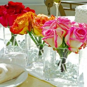 Inexpensive idea for DIY centerpieces for a wedding. Change the flowers based on the season.