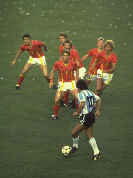 Diego Maradona of Argentina is confronted by a posse of Belgium defenders during…