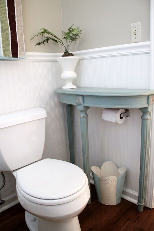 Hack for Small Bathrooms --> Attach a half table over the toilet paper holder for extra storage