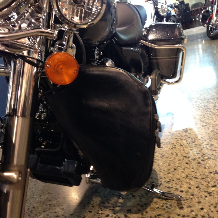 Crashbar wind guard, Full Grain Waxed leather with zippered pocket and adjustable zipper for added footrest, chrome buckle (plastic couplings come undone when a strong wind hits and it always happens at the wrong time) fastens it securely to the downtubes.