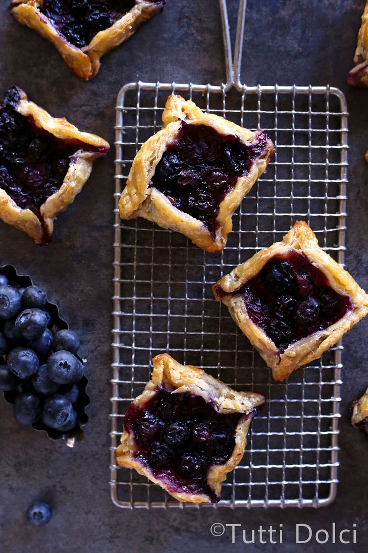 Mini Blueberry Galettes | buttery, flaky tarts topped with bursting blueberries, perfect for the 4th of July!