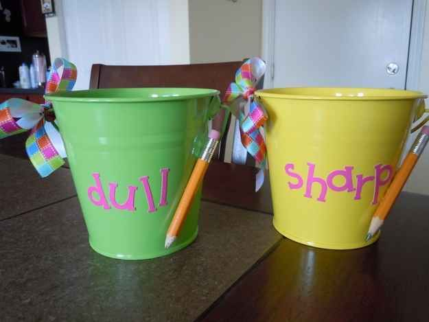 Create a pencil system with decorated buckets.