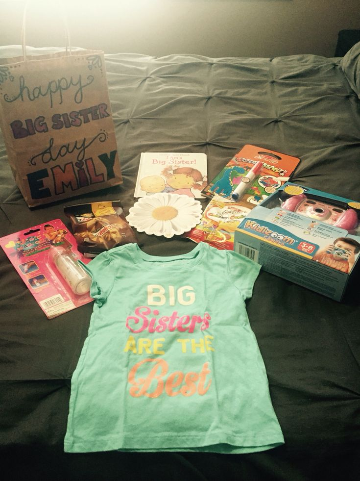 big sister gift. hospital gift. happy big sister day. big sister t-shirt, big sister book, favourite treats, colouring book, baby doll bottle, children's digital camera, card from mommy and daddy.