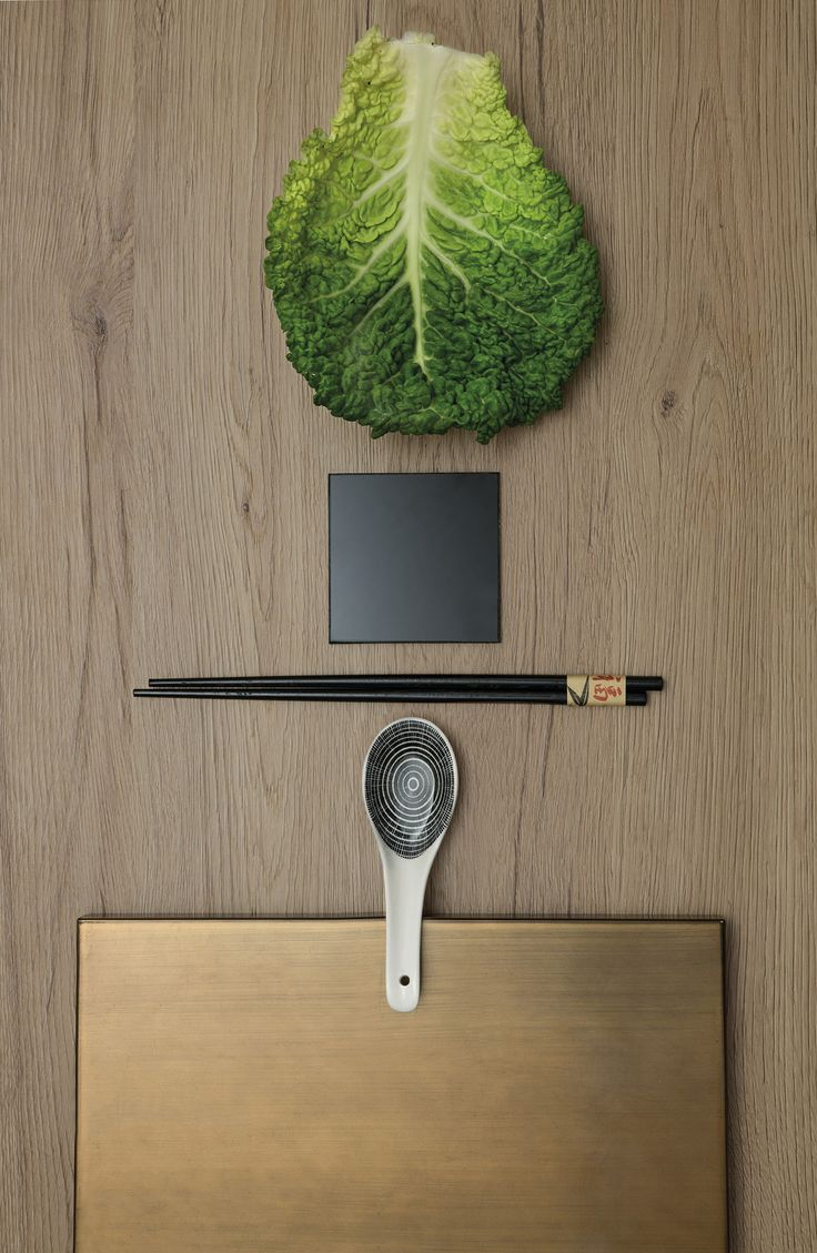 Graphic combination of brushed mink oak, lacquered glass and bronze metallic lacquered finishes.