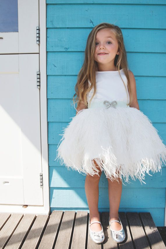 Exclusive satin dress with real feathers and small ribbon. On the front of the dress is a bow strass-aplication attached. Color dress: ivory. The dress is also available in soft pink: https://www.etsy.com/nl/listing/247681629/jurk-liv-roze-bruidsmeisje-bruidsjurkje?ref=listing-shop-header-0 Color ribbon: mint Do you want a this dress or ribbon in an other color? Please send us a message. Fabric colors may appear differently on your monitor or due to lighting in the photos. If you want you…