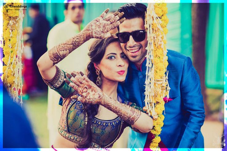 We're loving this vibrant Mehndi set up and this beautifully candid moment captured by @ Morvi Images Photography #evenddings #newexperience #indianwedding #weddingmoments #weddingevents #weddingdiaries #weddingplanner #event #newjourney #brides #groomsmen #marriagechallenge #marriagerocks #marriagegoals