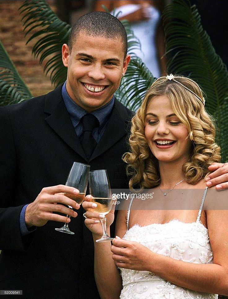 Soccer player Ronaldo is shown with his wife, Milene Domingues during their…