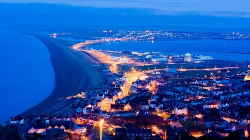 Chesil beach and Fortuneswell by night, with Weymouth beyone - taken from Portland