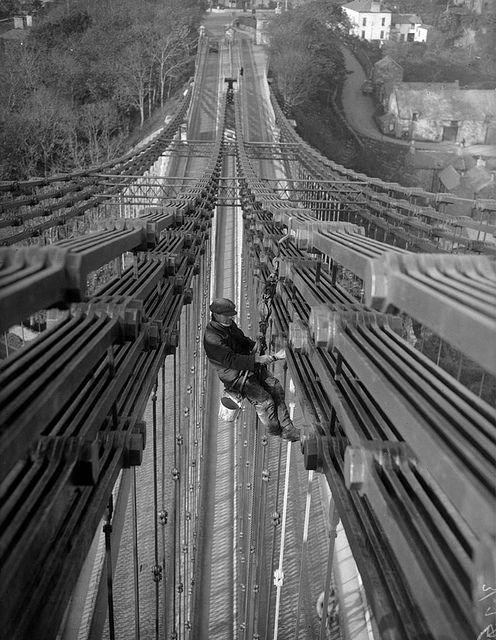 Painting the bridge over the Menai straits. North Wales, 1930